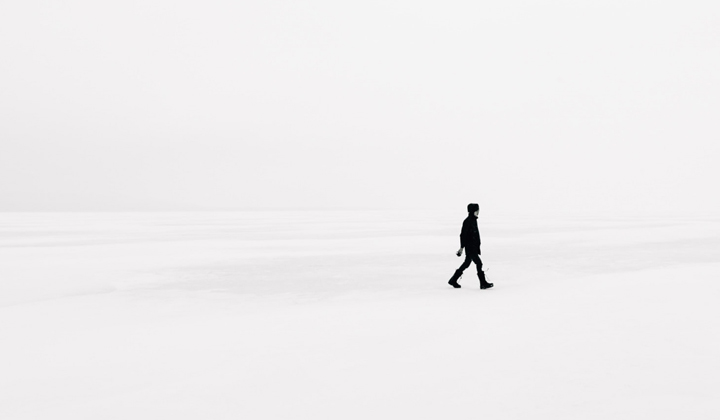 minimalist-website design still in fashion displays a picture of a man in the distance